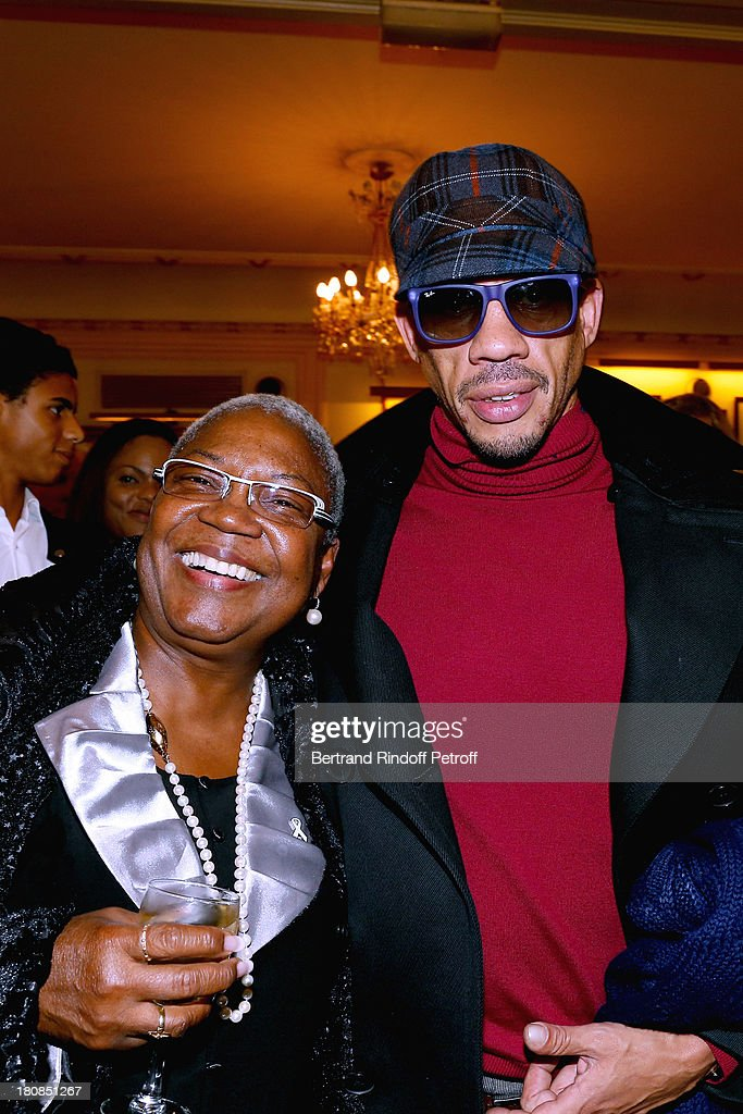 Actress <a gi-track='captionPersonalityLinkClicked' href=/galleries/search?phrase=Firmine+Richard&family=editorial&specificpeople=615504 ng-click='$event.stopPropagation()'>Firmine Richard</a> and Singer JoeyStarr (Didier Morville) after 'Nina' : Premiere at Theatre Edouard VII on September 16, 2013 in Paris, France.