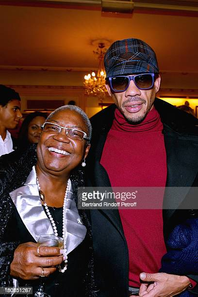 Actress Firmine Richard and Singer JoeyStarr after 'Nina' Premiere at Theatre Edouard VII on September 16 2013 in Paris France