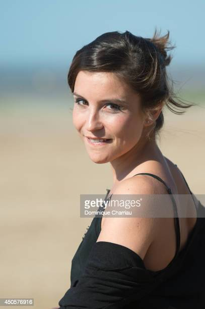 Actress Flore Bonaventura poses for a photocall during the 28th Cabourg Film Festival Day 3 on June 13 2014 in Cabourg France