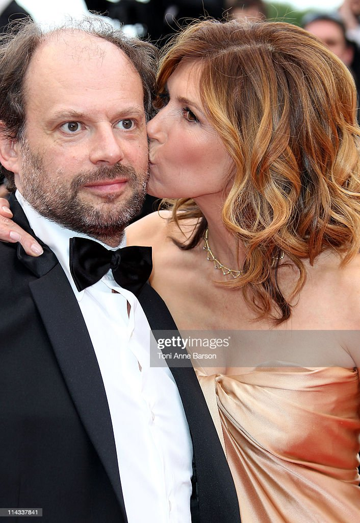 Actress Florence Pernel kisses actor Denis Podalydes as they attend the 'La Conquete' Premiere during the 64th Annual Cannes Film Festival at the Palais des Festivals on May 18, 2011 in Cannes, France.