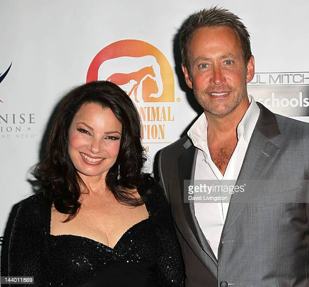 Actress Fran Drescher and writer Peter Marc Jacobson attend Paul Mitchell's 9th Annual Fundraiser at the Beverly Hilton on May 7 2012 in Beverly...