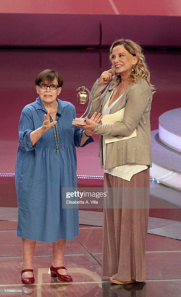 Actress Franca Valeri (L) receives Bellisario award from actress Simona Izzo attend Premio Bellisario 2013 at Dear RAI studios on June 20, 2013 in Rome, Italy.