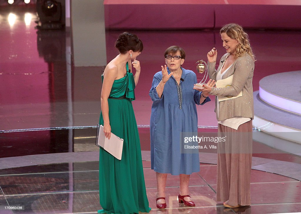 Actress Franca Valeri (C) receives Bellisario award from actress Simona Izzo during the Premio Bellisario 2013 at Dear RAI studios on June 20, 2013 in Rome, Italy.