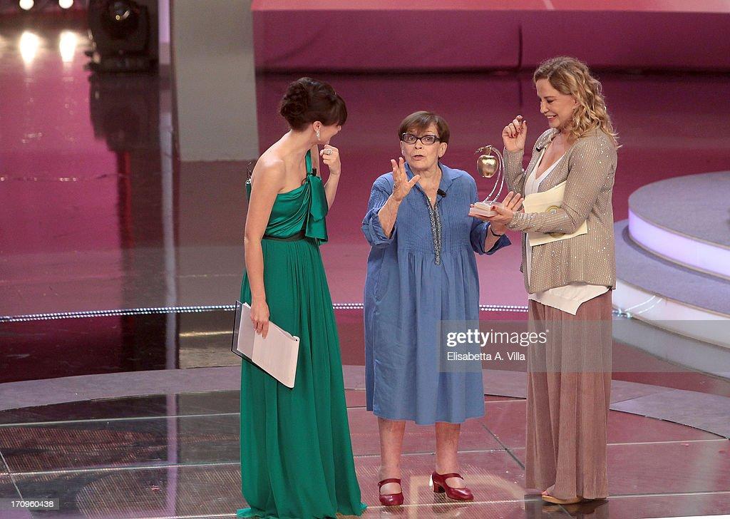 Actress Franca Valeri (C) receives Bellisario award from actress Simona Izzo during the Premio Bellisario 2013 at Dear RAI studios on June 20, 2013 in Rome, Italy.