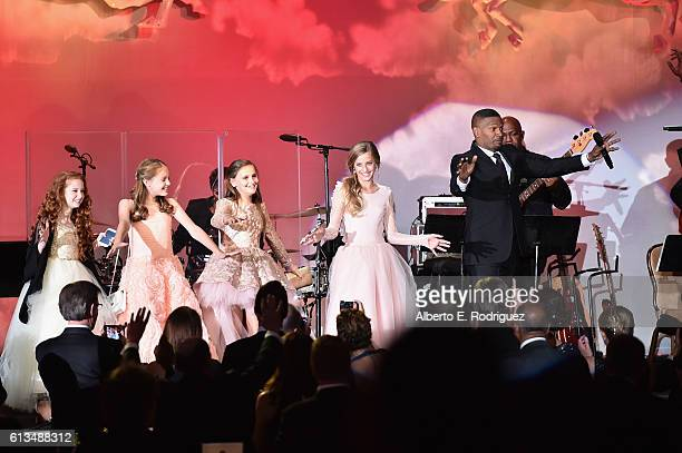 Actress Francesca Capaldi and actor/singer Jamie Foxx perform onstage during the 2016 Carousel Of Hope Ball at The Beverly Hilton Hotel on October 8...