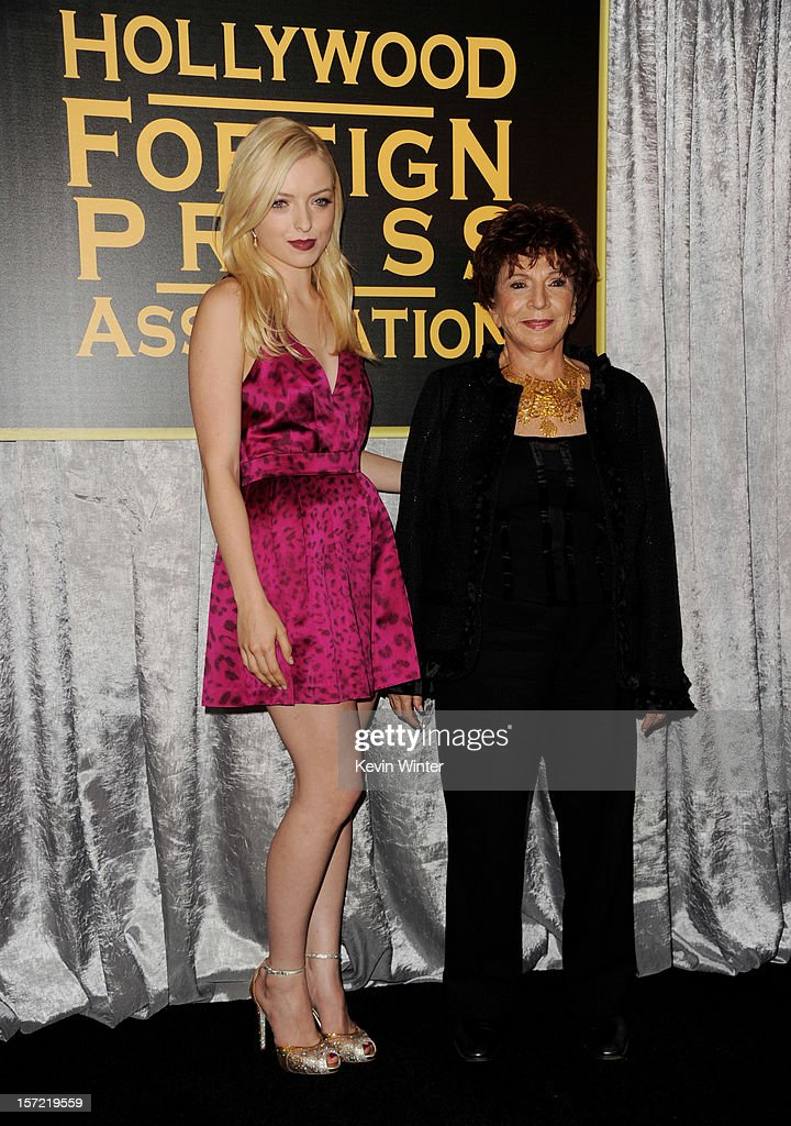 Actress Francesca Eastwood (L) is named Miss Golden Globe 2013 by HFPA president Dr. Aida Takla-O'Reilly at the Hollywood Foreign Press Association's and In Style's celebration of the 2013 Golden Globes Awards Season at Cecconi's on November 29, 2012 in West Hollywood, California.