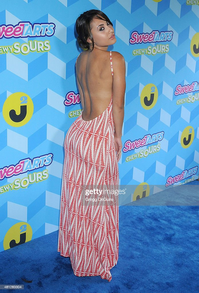 Actress Francia Raisa arrives at Just Jared's Summer Bash Pool Party 2015 on July 18 2015 in Los Angeles California
