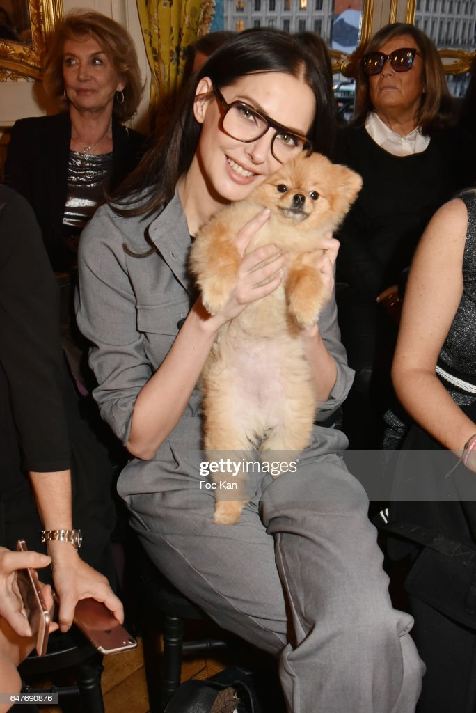 Actress Frederique Bel and dog Joca attend the Ingie show as part of the Paris Fashion Week Womenswear Fall/Winter 2017/2018 at Hotel Evreux on March 3, 2017 in Paris, France.