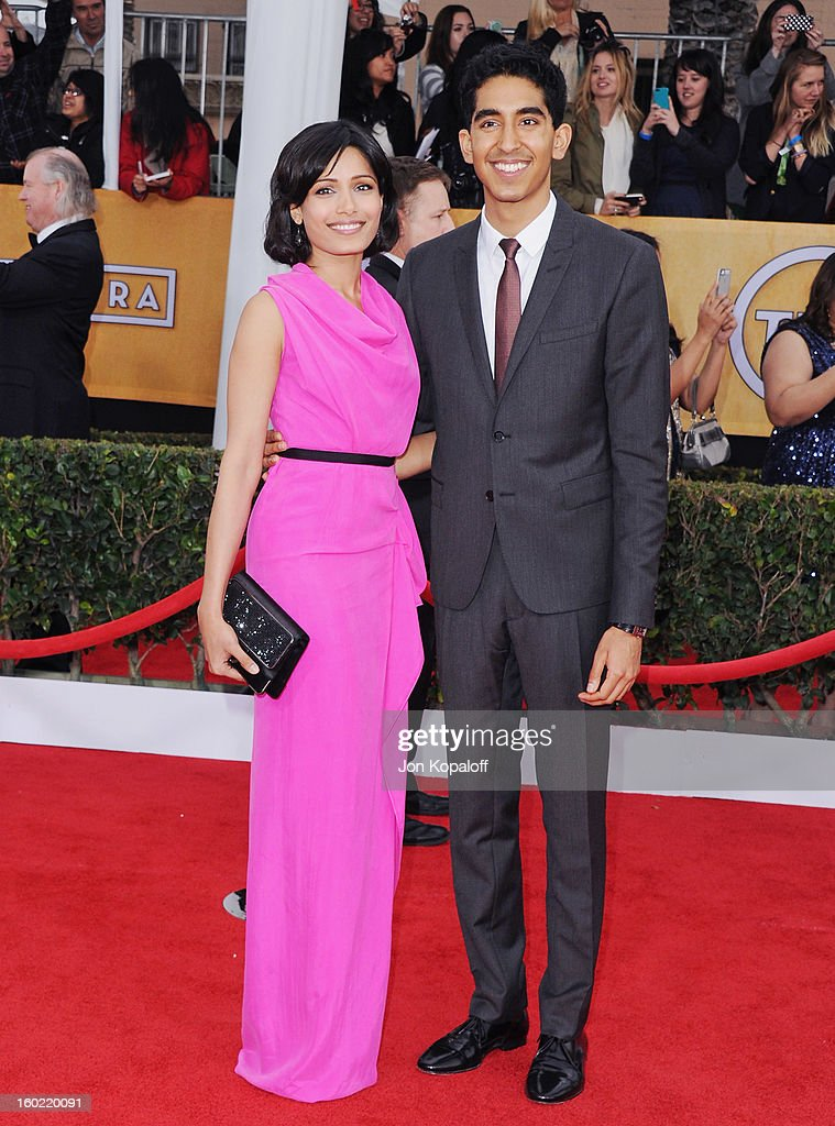 Actress Freida Pinto and actor Dev Patel arrive at the 19th Annual Screen Actors Guild Awards at The Shrine Auditorium on January 27, 2013 in Los Angeles, California.