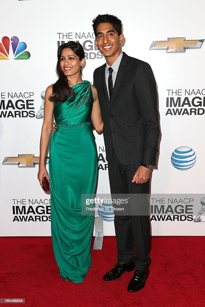 Actress Freida Pinto (L) and actor Dev Patel arrive at the 44th NAACP Image Awards held at The Shrine Auditorium on February 1, 2013 in Los Angeles, California.