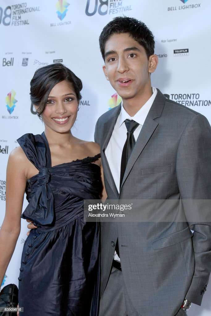 Actress Freida Pinto and actor Dev Patel arrive at the premiere of 'Slumdog Millionaire' held at Flow Resturant during the 2008 Toronto International Film Festival on Septmeber 7, 2008 in Toronto, Canada.