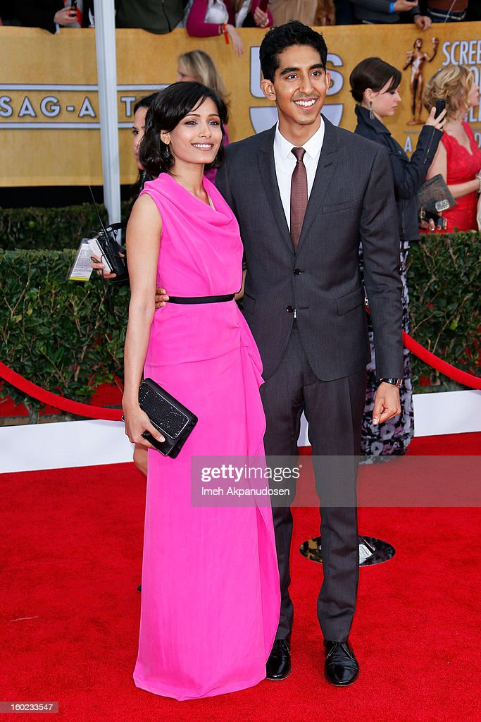 Actress Freida Pinto (L) and actor Dev Patel attend the 19th Annual Screen Actors Guild Awards at The Shrine Auditorium on January 27, 2013 in Los Angeles, California.