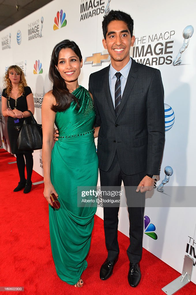 Actress Freida Pinto (L) and actor Dev Patel attend the 44th NAACP Image Awards at The Shrine Auditorium on February 1, 2013 in Los Angeles, California.