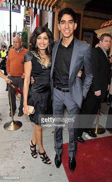 Actress Freida Pinto and actor Dev Patel attend the 'You Will Meet A Tall Dark Stranger' Premiere held at the Visa Screening Room At The Elgin...
