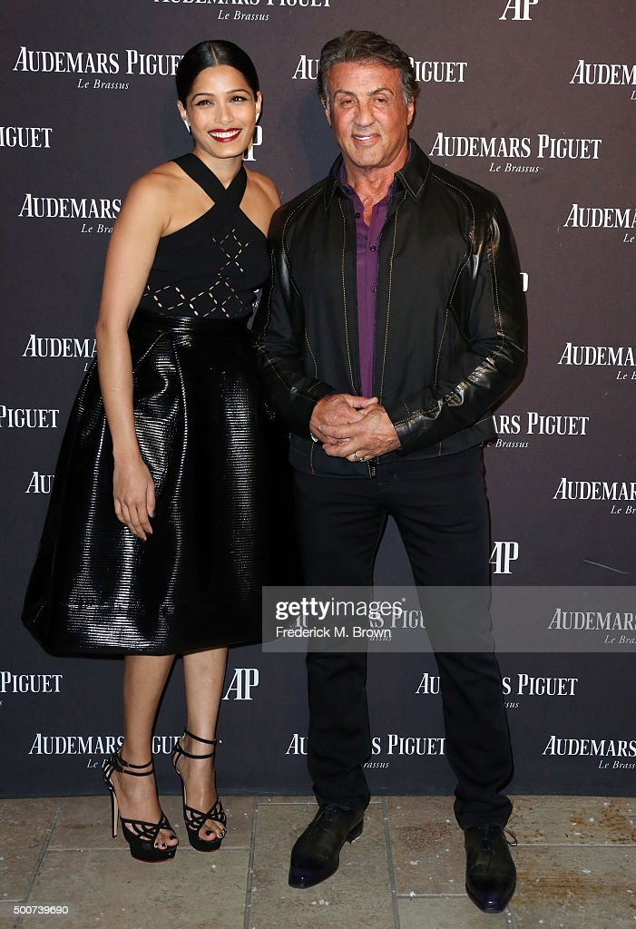 Actress Freida Pinto (L) and actor Sylvester Stallone attend Audemars Piquet Celebrates Grand Opening of Rodeo Drive Boutique on December 9, 2015 in Beverly Hills, California.