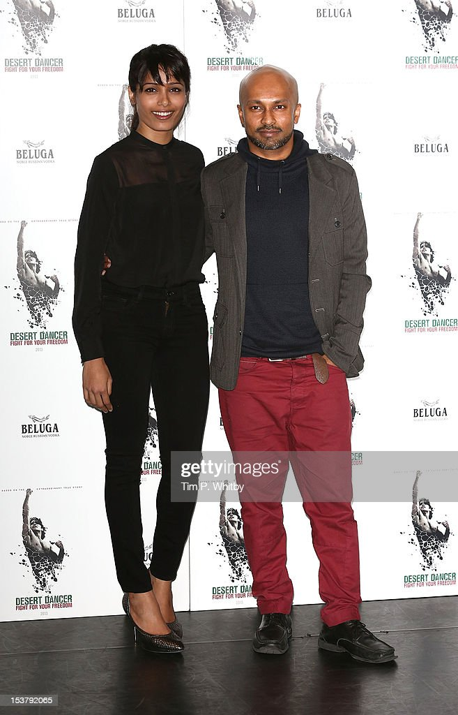 Actress Freida Pinto and Choreographer Akram Khan attend a photocall for 'Desert Dancer' at Sadler's Wells Theatre on October 9, 2012 in London, England.