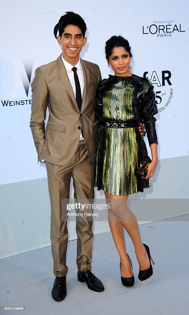 Actress Freida Pinto and Dev Patel attend amfAR's Cinema Against AIDS Gala during the 64th Annual Cannes Film Festival at Hotel Du Cap on May 19 2011...