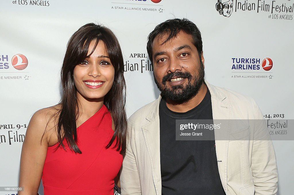Actress <a gi-track='captionPersonalityLinkClicked' href=/galleries/search?phrase=Freida+Pinto&family=editorial&specificpeople=5518973 ng-click='$event.stopPropagation()'>Freida Pinto</a> and director Anurag Kashyap attend the Indian Film Festival of Los Angeles (IFFLA) Opening Night Gala for 'Gangs Of Wasseypur' at ArcLight Cinemas on April 9, 2013 in Hollywood, California.