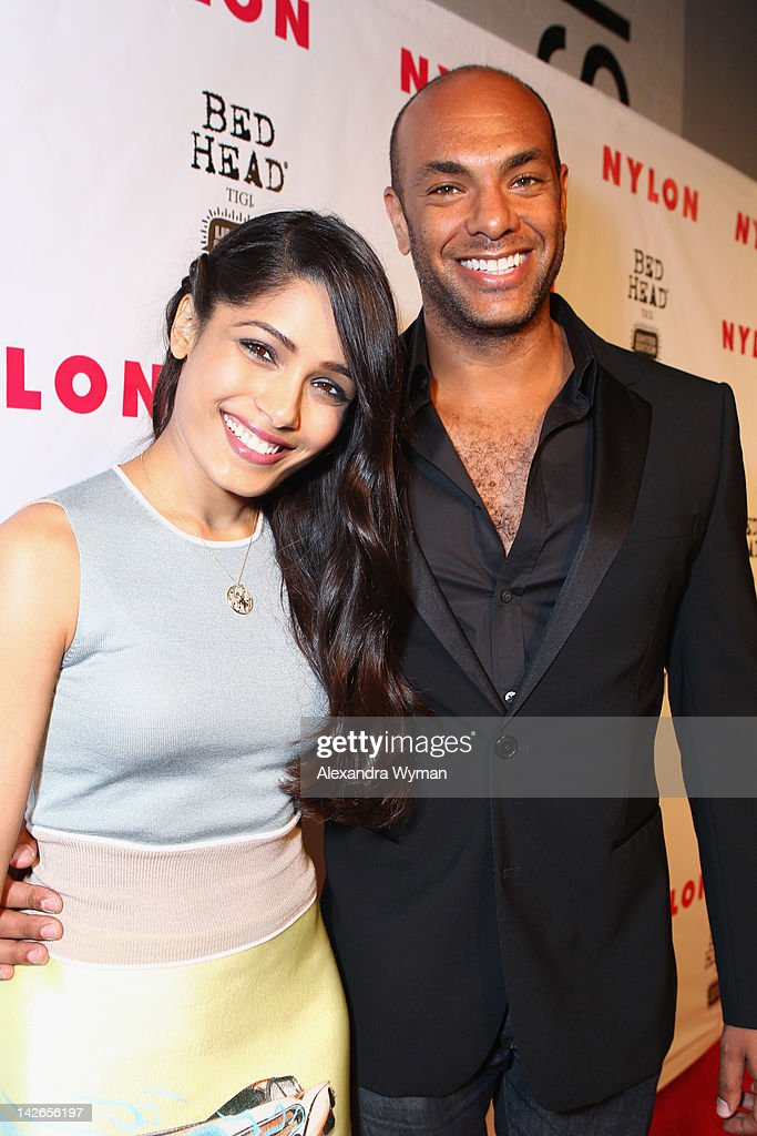 Actress <a gi-track='captionPersonalityLinkClicked' href=/galleries/search?phrase=Freida+Pinto&family=editorial&specificpeople=5518973 ng-click='$event.stopPropagation()'>Freida Pinto</a> (L) and NYLON associate publisher Karim Abay attend the NYLON Magazine 13th Anniversary Celebration Presented by Beadhead by Tiji at Smashbox West Hollywood on April 10, 2012 in West Hollywood, California.