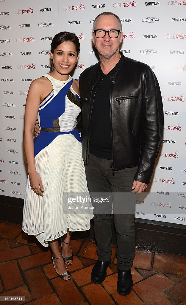 Actress Freida Pinto and Publisher of Vanity Fair Edward Menicheschi attend Vanity Fair and L'Oréal Paris-hosted D.J. Night with Freida Pinto in support of 10 x 10 and 'Girl Rising' at Teddy's at The Hollywood Roosevelt Hotel on February 19, 2013 in Los Angeles, California.