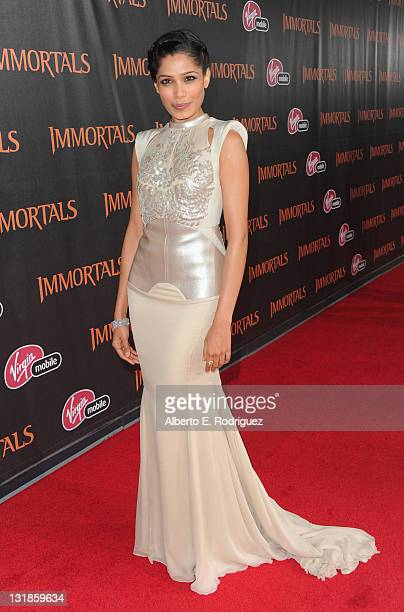 Actress Freida Pinto arrives at Relativity Media's Immortals premiere presented in RealD 3 at Nokia Theatre LA Live on November 7 2011 in Los Angeles...
