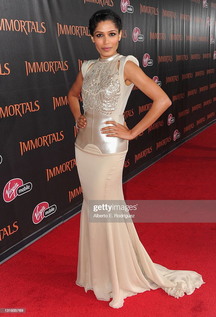 Actress <a gi-track='captionPersonalityLinkClicked' href=/galleries/search?phrase=Freida+Pinto&family=editorial&specificpeople=5518973 ng-click='$event.stopPropagation()'>Freida Pinto</a> arrives at Relativity Media's 'Immortals' premiere presented in RealD 3 at Nokia Theatre L.A. Live at Nokia Theatre L.A. Live on November 7, 2011 in Los Angeles, California.