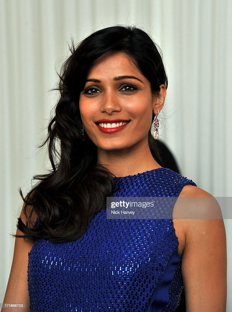 Actress Freida Pinto attends the 15th Annual White Tie and Tiara Ball to Benefit Elton John AIDS Foundation in Association with Chopard at Woodside on June 27, 2013 in Windsor, England. No sales to online/digital media worldwide until the 14th of July. No sales before July 14th, 2013 in UK, Spain, Switzerland, Mexico, Dubai, Russia, Serbia, Bulgaria, Turkey, Argentina, Chile, Peru, Ecuador, Colombia, Venezuela, Puerto Rico, Dominican Republic, Greece, Canada, Thailand, Indonesia, Morocco, Malaysia, India, Pakistan, Nigeria. All pictures are for editorial use only and mention of 'Chopard' and 'The Elton John Aids Foundation' are compulsory. No sales ever to Ok, Now, Closer, Reveal, Heat, Look or Grazia magazines in the United Kingdom. No sales ever to any jewellers or watchmakers other than Chopard.