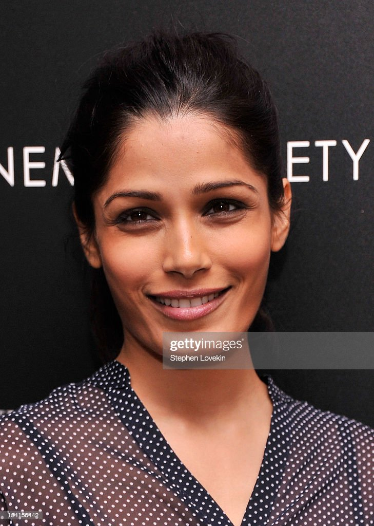 Actress Freida Pinto attends The Cinema Society with Vanity Fair & Richard Mille screening of DreamWorks Pictures' 'The Fifth Estate' at the Crosby Street Hotel on October 11, 2013 in New York City.