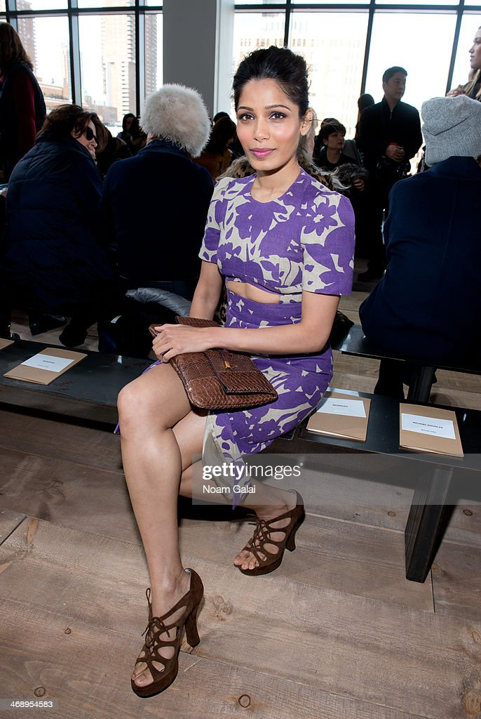 Actress <a gi-track='captionPersonalityLinkClicked' href=/galleries/search?phrase=Freida+Pinto&family=editorial&specificpeople=5518973 ng-click='$event.stopPropagation()'>Freida Pinto</a> attends the Michael Kors Show during Mercedes-Benz Fashion Week Fall 2014 at Spring Studios on February 12, 2014 in New York City.