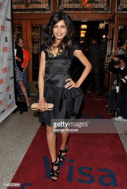 Actress Freida Pinto attends the 'You Will Meet A Tall Dark Stranger' Premiere held at the Visa Screening Room At The Elgin Theatre during the 35th...