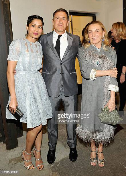 Actress Freida Pinto director David O Russell and Miuccia Prada attend the premiere of 'Past Forward' a movie by David O Russell presented by Prada...