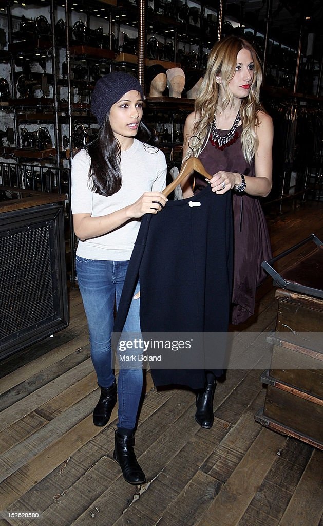 Actress <a gi-track='captionPersonalityLinkClicked' href=/galleries/search?phrase=Freida+Pinto&family=editorial&specificpeople=5518973 ng-click='$event.stopPropagation()'>Freida Pinto</a> (L) is seen visiting All Saints on September 23, 2012 in London, England.