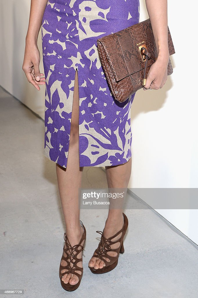 Actress Freida Pinto (fashion detail) poses backstage at the Michael Kors fashion show during Mercedes-Benz Fashion Week Fall 2014 at Spring Studios on February 12, 2014 in New York City.