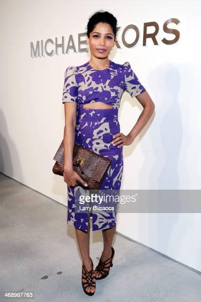 Actress Freida Pinto poses backstage at the Michael Kors fashion show during MercedesBenz Fashion Week Fall 2014 at Spring Studios on February 12...
