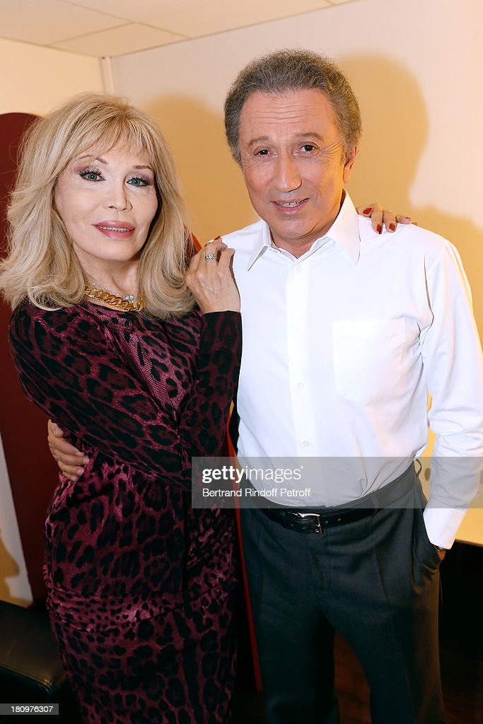 Actress from piece 'Divina' <a gi-track='captionPersonalityLinkClicked' href=/galleries/search?phrase=Amanda+Lear&family=editorial&specificpeople=2028746 ng-click='$event.stopPropagation()'>Amanda Lear</a> and presenter of the show <a gi-track='captionPersonalityLinkClicked' href=/galleries/search?phrase=Michel+Drucker&family=editorial&specificpeople=769504 ng-click='$event.stopPropagation()'>Michel Drucker</a> attend 'Vivement Dimanche' French TV Show at Pavillon Gabriel on September 18, 2013 in Paris, France.