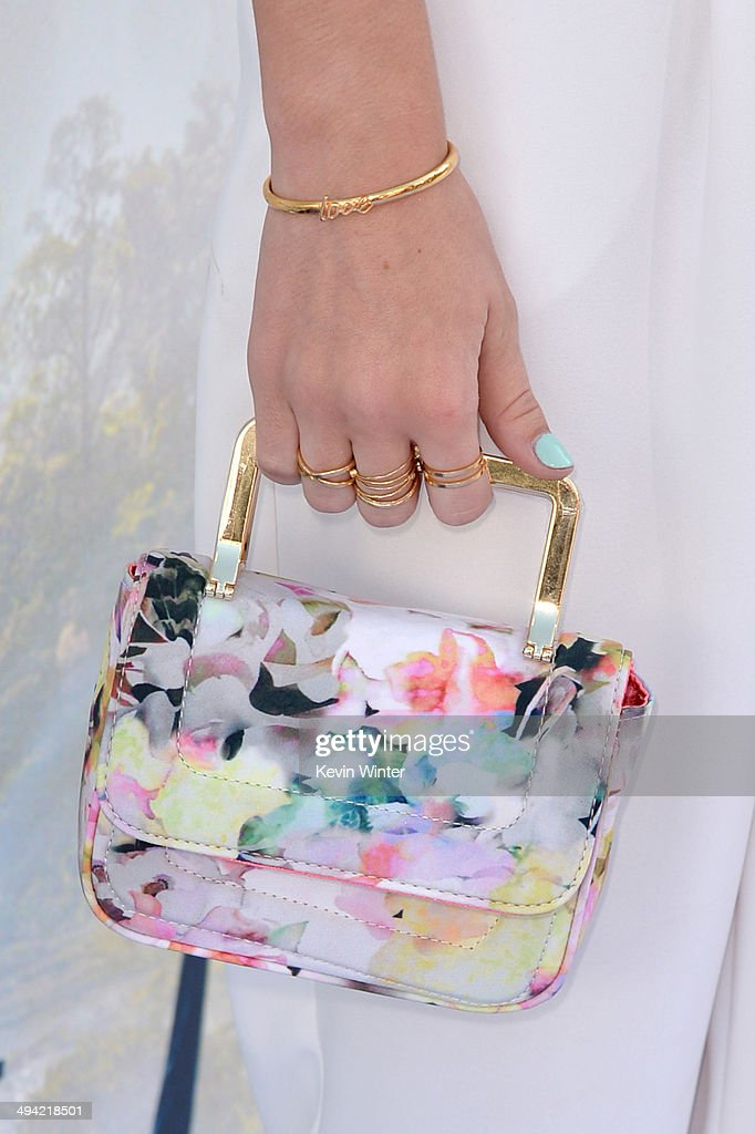 Actress G. Hannelius (handbag detail) attends the World Premiere of Disney's 'Maleficent' at the El Capitan Theatre on May 28, 2014 in Hollywood, California.