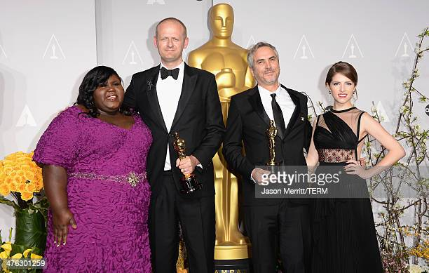 Actress Gabourey Sidibe editor Mark Sanger director Alfonso Cuarón winners of Best Achievement in Editing and actress Anna Kendrick pose in the press...