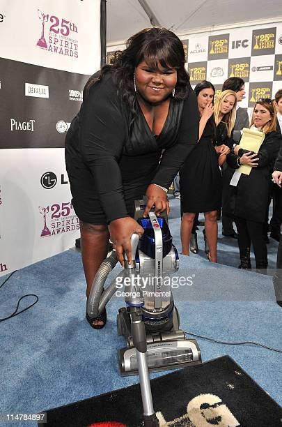 Actress Gabourey Sidibe with the LG Electronics Kompressor Vacuum on The 25th Spirit Awards Blue Carpet held at Nokia Theatre LA Live on March 5 2010...