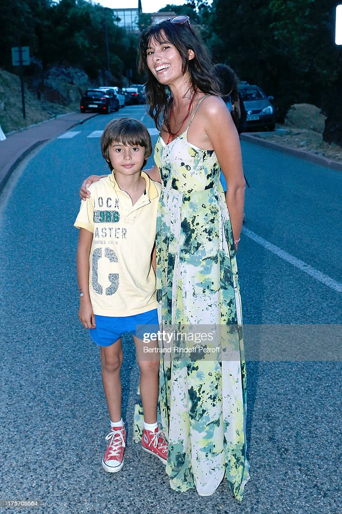 Actress Gabriela White and her son Mickael Sean attend Magician Eric Antoine's show, 'Le mix sous les etoiles' on day 7 of the 29th Ramatuelle Festival on August 6, 2013 in Ramatuelle, France.