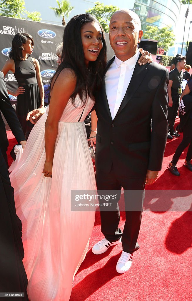 Actress Gabrielle Union (L) and entrepreneur Russell Simmons attend the BET AWARDS '14 at Nokia Theatre L.A. LIVE on June 29, 2014 in Los Angeles, California.