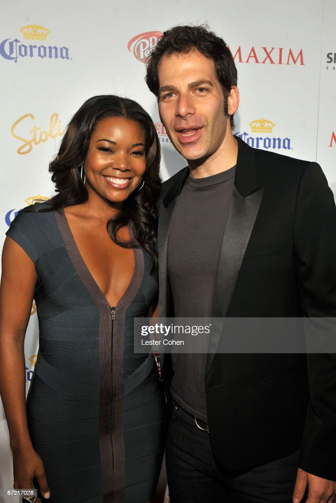 Actress Gabrielle Union and Maxim editor and chief Joe Levy arrive at Maxim's 10th Annual Hot 100 Celebration Presented by Dr Pepper Cherry, True Religion Brand Jeans, Stolichnaya Vodka and Corona held at Barker Hangar on May 13, 2009 in Santa Monica, California.