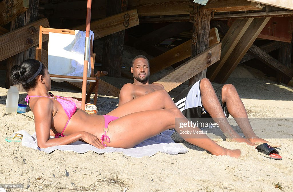 Actress <a gi-track='captionPersonalityLinkClicked' href=/galleries/search?phrase=Gabrielle+Union&family=editorial&specificpeople=202066 ng-click='$event.stopPropagation()'>Gabrielle Union</a> and Miami Heat basketball player <a gi-track='captionPersonalityLinkClicked' href=/galleries/search?phrase=Dwyane+Wade&family=editorial&specificpeople=201481 ng-click='$event.stopPropagation()'>Dwyane Wade</a> are sighted enjoying a beach outing on September 21, 2013 in Malibu, California.