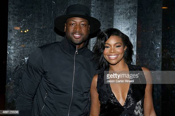 Actress Gabrielle Union and NBA player Dwyane Wade pose at Skylight at Moynihan Station during Spring 2016 New York Fashion Week The Shows on...