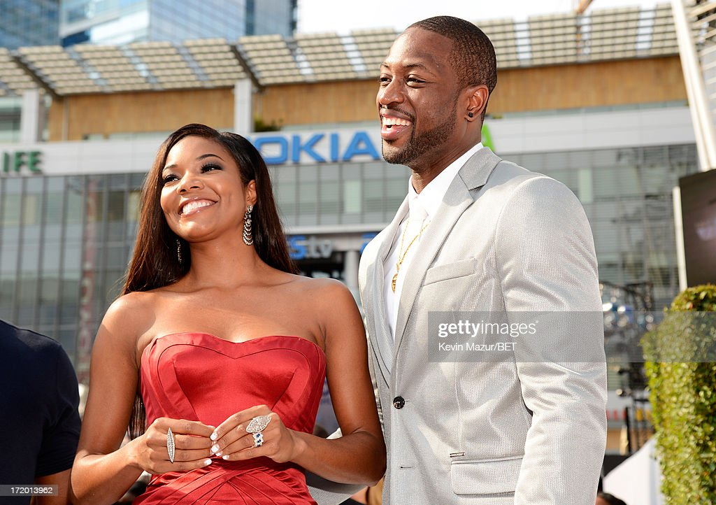 Actress <a gi-track='captionPersonalityLinkClicked' href=/galleries/search?phrase=Gabrielle+Union&family=editorial&specificpeople=202066 ng-click='$event.stopPropagation()'>Gabrielle Union</a> and professional basketball player <a gi-track='captionPersonalityLinkClicked' href=/galleries/search?phrase=Dwyane+Wade&family=editorial&specificpeople=201481 ng-click='$event.stopPropagation()'>Dwyane Wade</a> attend the Ford Red Carpet at the 2013 BET Awards at Nokia Theatre L.A. Live on June 30, 2013 in Los Angeles, California.