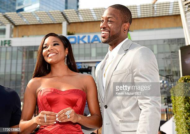 Actress Gabrielle Union and professional basketball player Dwyane Wade attend the Ford Red Carpet at the 2013 BET Awards at Nokia Theatre LA Live on...