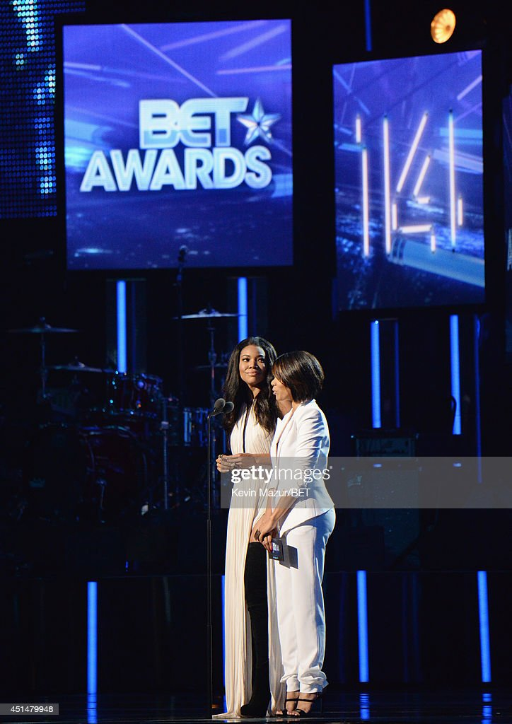 Actress Gabrielle Union and Regina Hall onstage during the BET AWARDS '14 at Nokia Theatre L.A. LIVE on June 29, 2014 in Los Angeles, California.