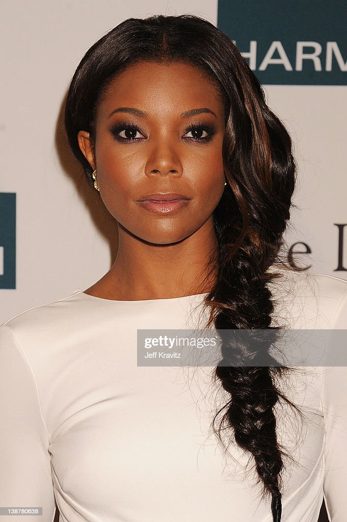 Actress <a gi-track='captionPersonalityLinkClicked' href=/galleries/search?phrase=Gabrielle+Union&family=editorial&specificpeople=202066 ng-click='$event.stopPropagation()'>Gabrielle Union</a> arrives at Clive Davis and the Recording Academy's 2012 Pre-GRAMMY Gala and Salute to Industry Icons Honoring Richard Branson held at The Beverly Hilton Hotel on February 11, 2012 in Beverly Hills, California.