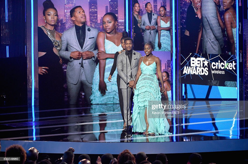 Actress <a gi-track='captionPersonalityLinkClicked' href=/galleries/search?phrase=Gabrielle+Union&family=editorial&specificpeople=202066 ng-click='$event.stopPropagation()'>Gabrielle Union</a>, director/actor <a gi-track='captionPersonalityLinkClicked' href=/galleries/search?phrase=Nate+Parker+-+Actor&family=editorial&specificpeople=14598637 ng-click='$event.stopPropagation()'>Nate Parker</a> and actress <a gi-track='captionPersonalityLinkClicked' href=/galleries/search?phrase=Aja+Naomi+King&family=editorial&specificpeople=9333659 ng-click='$event.stopPropagation()'>Aja Naomi King</a> speak onstage during the 2016 BET Awards at the Microsoft Theater on June 26, 2016 in Los Angeles, California.