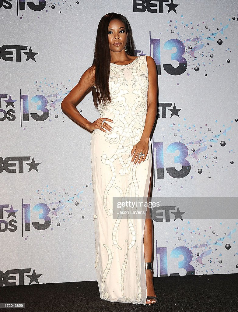 Actress <a gi-track='captionPersonalityLinkClicked' href=/galleries/search?phrase=Gabrielle+Union&family=editorial&specificpeople=202066 ng-click='$event.stopPropagation()'>Gabrielle Union</a> poses in the press room at the 2013 BET Awards at Nokia Theatre L.A. Live on June 30, 2013 in Los Angeles, California.
