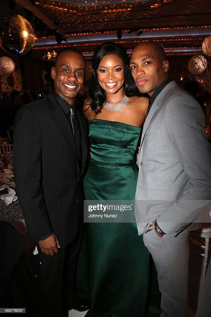 Actress <a gi-track='captionPersonalityLinkClicked' href=/galleries/search?phrase=Gabrielle+Union&family=editorial&specificpeople=202066 ng-click='$event.stopPropagation()'>Gabrielle Union</a> (C) poses with Alvin Ailey's Kirven Douthit-Boyd (L) and Antonio Douthit-Boyd at the 2013 Alvin Ailey American Dance Theater's opening night benefit gala at New York City Center on December 4, 2013 in New York City.